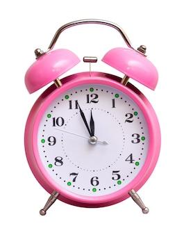 分離された白のピンクの時計、約12時間を示しています