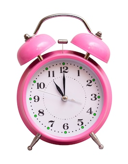 The pink clock on a white isolated show 11 hour