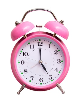 The pink clock on a white isolated show 5 hour