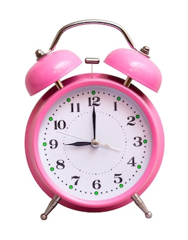 The pink clock on a white isolated show 9 hour
