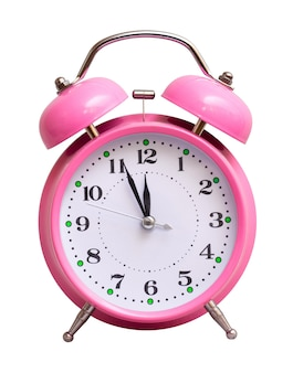 Pink clock on white isolated, which shows the approximate 12 hours