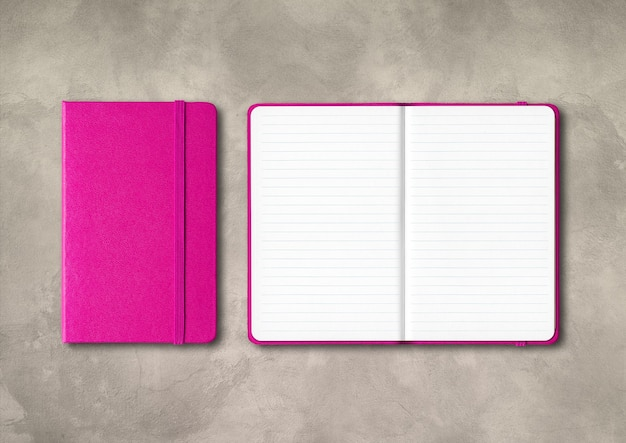 Pink closed and open lined notebooks mockup isolated on concrete