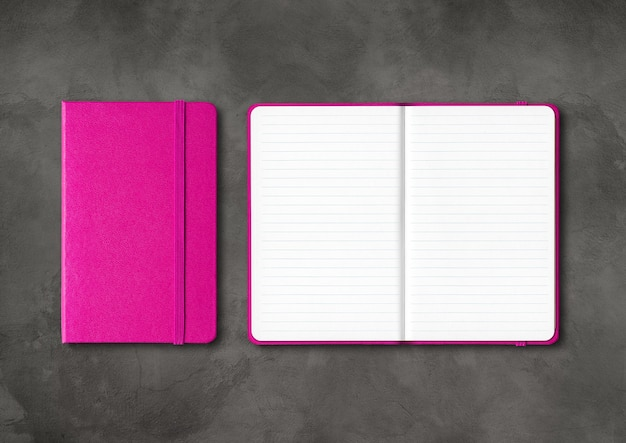 Pink closed and open lined notebooks mockup isolated on dark concrete background