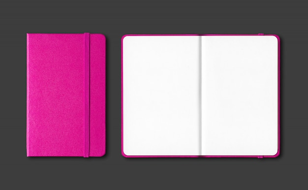 Pink closed and open notebooks isolated on black