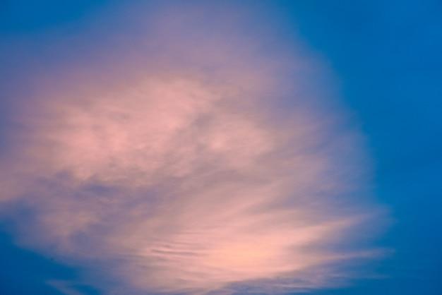 Pink clouds in blue sky