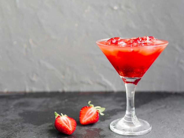 Pink cocktail drink with strawberries