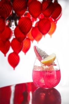 Pink color cocktail on table
