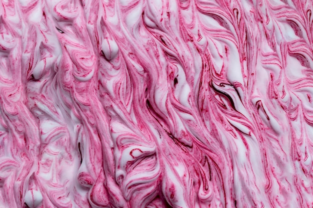 Pink color paint mixed in white foam background