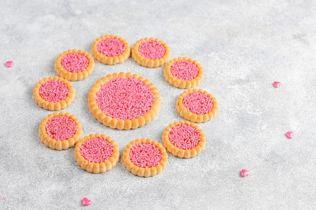 Pink color sweets,candies,meringue and sugar.