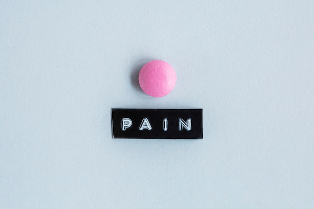 Pink color table with pain label
