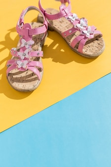 Pink colored shoes, minimalistic summer fashion concept.