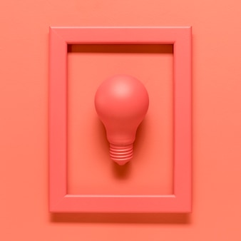 Pink composition with lamp in frame on colored surface