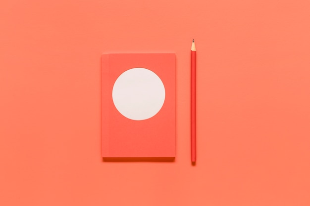 Pink composition with office tools on colored surface