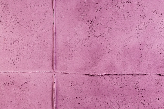 Pink concrete wall surface with joint