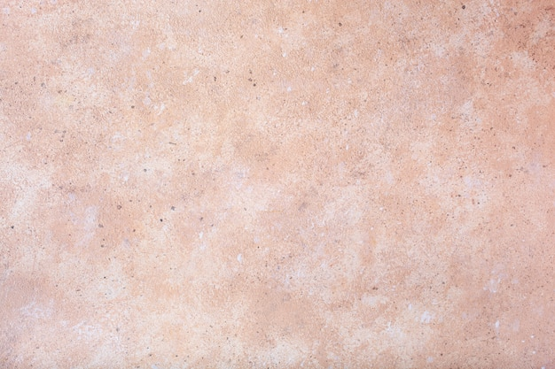 Розовая предпосылка текстуры бетонной стены.