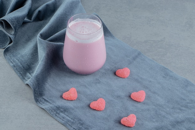 Pink cookie and milk shake on the towel, on the marble background. high quality photo