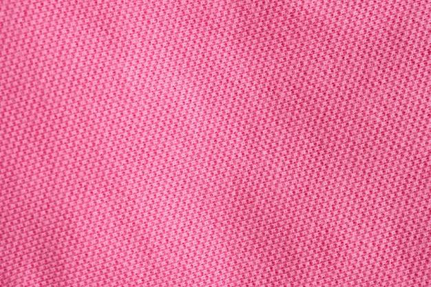 Розовая хлопковая ткань текстуры крупным планом фон
