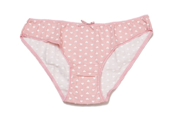 Pink cotton panties on white isolated background. woman underwear set. top view.