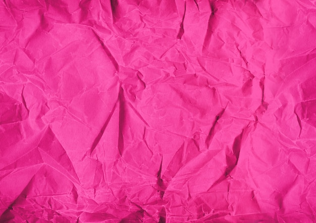Pink crumpled paper texture background