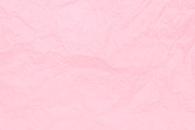 Pink crumpled sheet of paper background