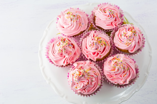 Pink cupcakes  on cake stand top view
