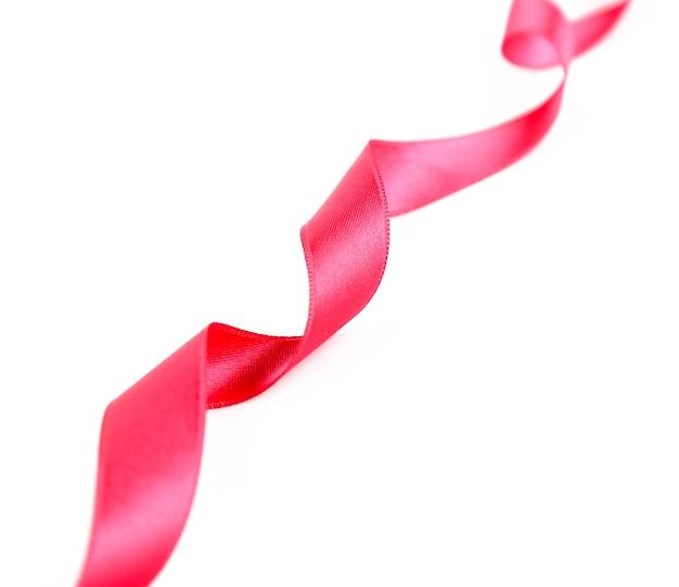 白で隔離のピンクの巻き毛のリボン