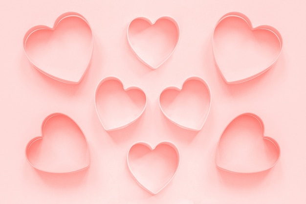 Pink cutters cookies in heart shapel in colar toned. love romantic pattern, template