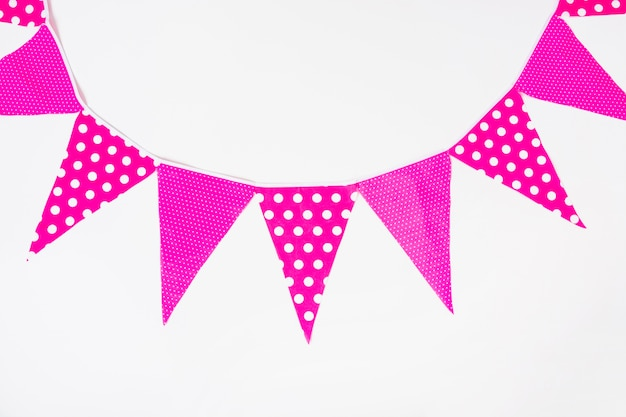 Pink decorative bunting flags on white background
