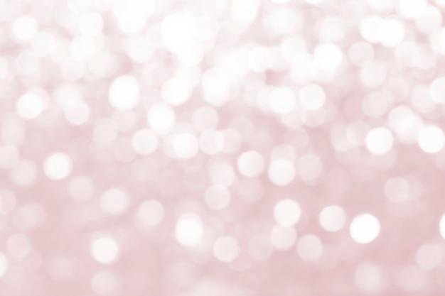 ピンクのデフォーカスキラキラ背景デザイン