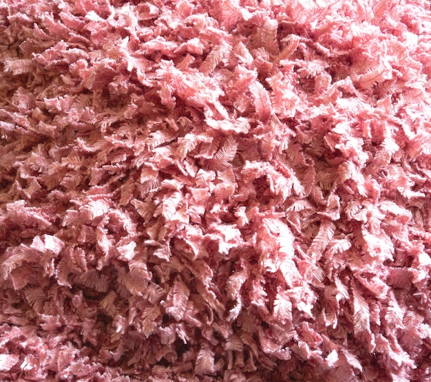 Pink delicate wool fluffy fabric for background texture
