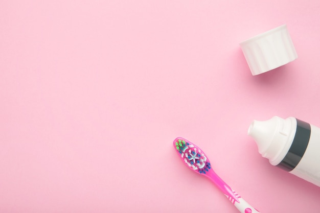 Pink dental brush with tooth paste isolated