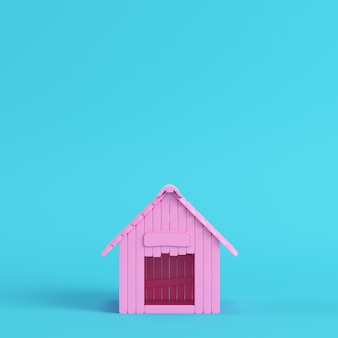Pink doghouse on bright blue background