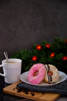 Pink donuts on plate withe coffee