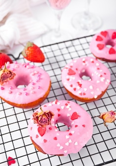 Pink doughnuts on the baking rack. valentine's day concept. top view. close up.