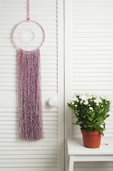 Pink dream catcher with flowers