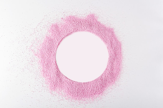 Pink dried strawberries powder like as frame circle on white background with copy space for text
