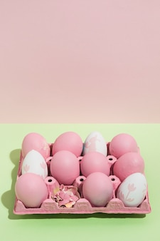 Pink easter eggs in big rack on table
