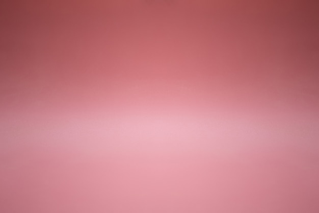 Pink empty display table board with gradient lighting used for background and display your product