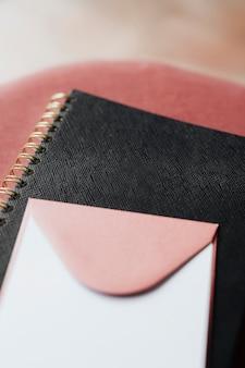 Pink envelope on a black notebook