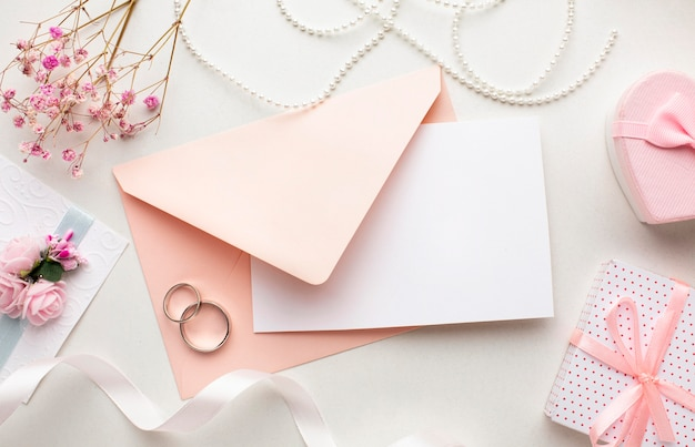 Pink envelope and rings save the date wedding concept