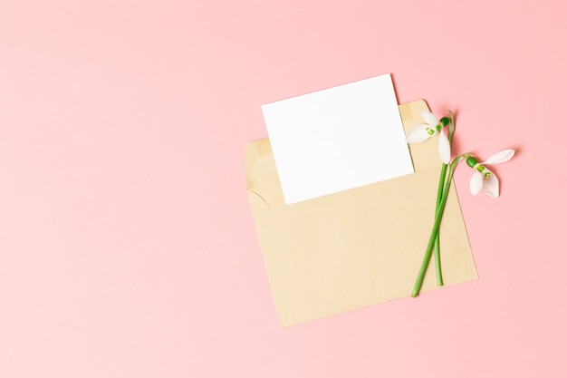 Pink envelope with a spring flower arrangement.
