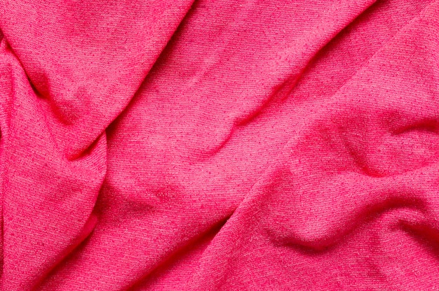 Pink fabric close-up background
