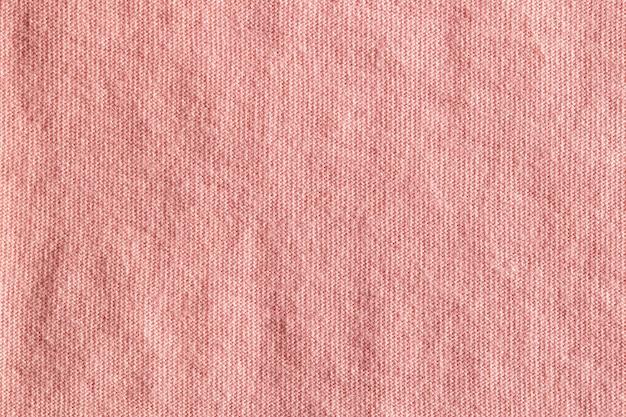 Розовая текстура полиэстера ткани ткани и предпосылка ткани.