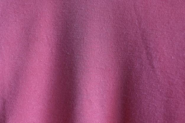 ピンクの生地の質感の表面デザイン