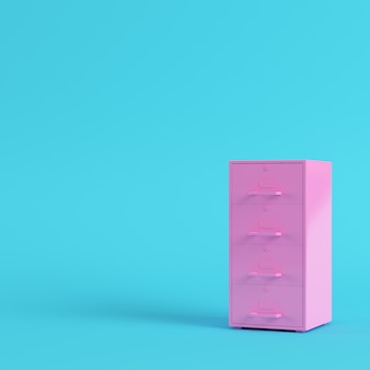 Pink filing cabinet on bright blue background