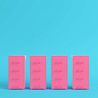 Pink filing cabinets on bright blue background