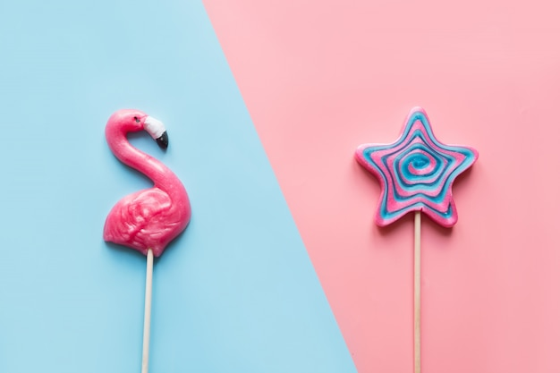 Pink flamingo and star candy lollipop on blue and pink.
