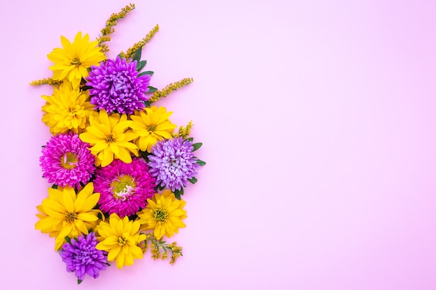 Pink floral card with purple aster flowers and wild yellow chamomile.