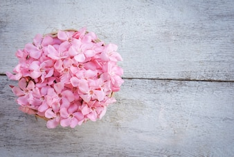 Pink flower bouquet on white wooden table background