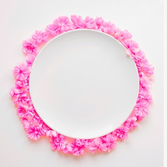 Pink flowers around plate